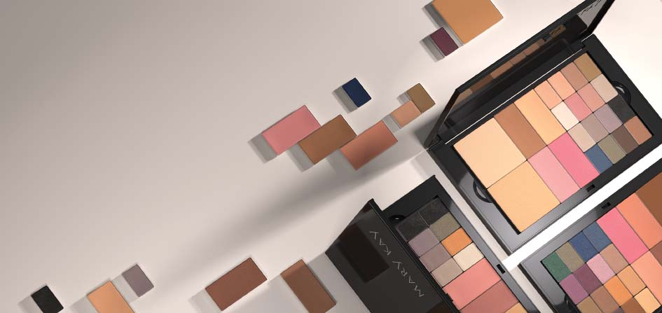 Three new Mary Kay Pro Palettes™ sit open with pans of makeup organized neatly inside.