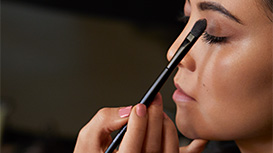 Mary Kay Chromafusion Eye Shadow being applied to model's eyelid.