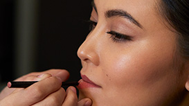 Mary Kay Lip Liner being applied to model's lips.