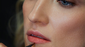 Mary Kay Gel Semi-Shine Lipstick being applied to model's lips with a Mary Kay Cream Color Brush.