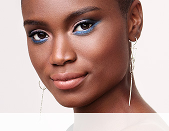 Close-up of model wearing Radiate Confidence makeup artist look from Mary Kay against a white background