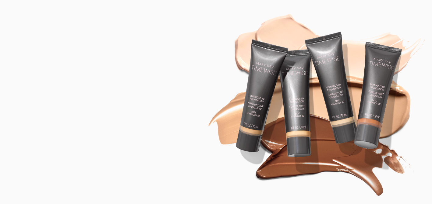 TimeWise® Luminous 3D Foundation tubes on product rubs in ivory, beige and bronze shades