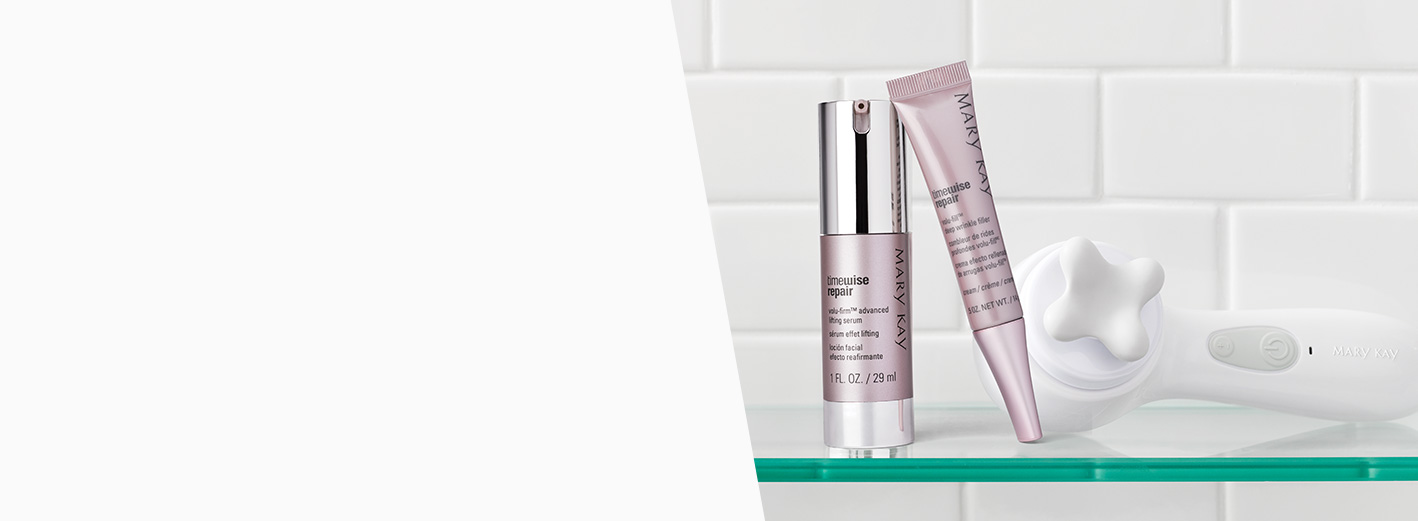 TimeWise Repair® Volu-Firm® Advanced Lifting Serum and TimeWise Repair® Volu-Fill® Deep Wrinkle Filler are shown on a shelf along with the Skinvigorate Sonic™ device and facial massage head.